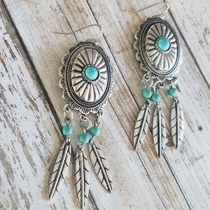 Conch dream catcher earrings